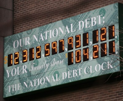 The National Debt Clock is shown Monday, Feb. 1, 2010 in New York. President Barack Obama sent Congress a $3.83 trillion budget on Monday that would pour more money into the fight against high unemployment, boost taxes on the wealthy and freeze spending for a wide swath of government programs. The deficit for this year would surge to a record-breaking $1.56 trillion. The Debt Clock is a privately funded estimate of the national debt. (AP Photo/Mark Lennihan)