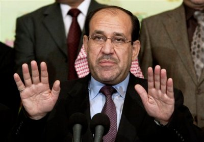 In this Friday, March 26, 2010 file photo, Iraqi Prime Minister Nouri al-Maliki speaks to the press in Baghdad, Iraq. Iraq's Nouri al-Maliki has given up his post as prime minister to Haider al-Abadi, state television reported Thursday, Aug. 14, 2014 — a move that could end a political deadlock that plunged Baghdad into uncertainty as the country fights a Sunni militant insurgency. (AP Photo/Hadi Mizban, File)