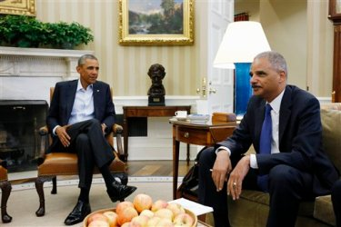 This Aug. 18, 2014 file photo shows President Barack Obama meeting with Attorney General Eric Holder  in the Oval Office of the White House in Washington. Holder, who is leading the federal response to the racial turmoil in Ferguson, Missouri, talks about the nation's civil rights struggles in a way none of the 81 previous U.S. attorneys general could _ by telling his own family story. (AP Photo/Charles Dharapak, File)