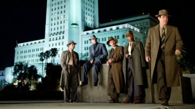 "This is a poster for 2013's ""Gangster Squad,"" which is taken in front of Los Angeles City Hall, where many scenes of the movie were filmed. The production of feature films in Los Angeles County has fallen by half since 1996, according to FilmL.A. Inc. (Courtesy of Warner Bros. Pictures)"
