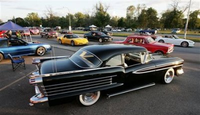 Cruisers pass by this 1958 Oldsmobile along Woodward Avenue in Royal Oak, Mich. on  Friday Aug. 15, 2008, ahead of Saturday's Woodward Dream Cruise, which is expected to draw thousands of classic car enthusiasts from around the country. (AP Photo/Robin Buckson / The Detroit News)