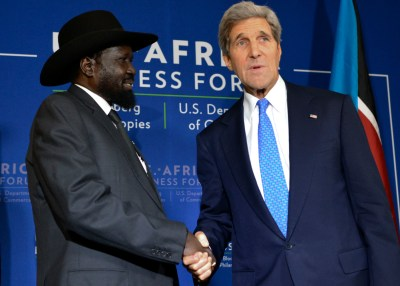 South Sudanese President Salva Kiir (left) shakes hands with U.S. Secretary of State John Kerry during a brief bilateral meeting at the U.S.-Africa Leaders Summit in Washington, D.C. (Freddie Allen/NNPA)