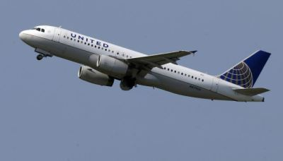 In this Tuesday, July 23, 2013, photo, a United Airlines jet takes off from Pittsburgh International Airport in Imperial, Pa. United Airlines reports quarterly earnings on Thursday, July 25, 2013.  (AP Photo/Gene J. Puskar)