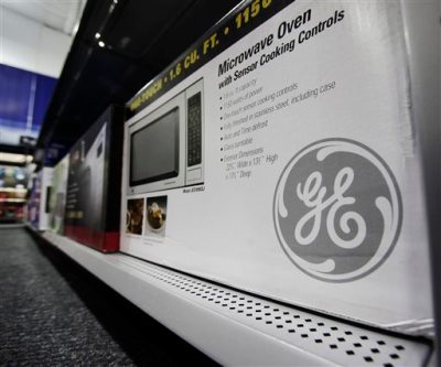 In this photo made Oct. 14, 2009, a General Electric (GE) microwave is shown at Best Buy in Mountain View, Calif. The sale of GE's appliance division, announced Monday, Sept. 8, 2014, is the latest in a long string of moves by the company to shift its focus away from consumers and toward the manufacturing of giant, complex industrial machines such as aircraft engines, locomotives, gas-fired turbines and medical imaging equipment. (AP Photo/Paul Sakuma, File)