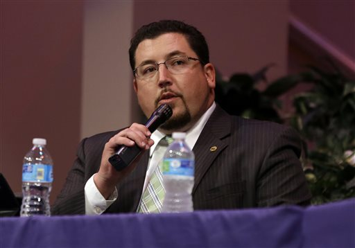 Ferguson Mayor James Knowles speaks during a meeting of the Ferguson City Council Tuesday, Sept. 9, 2014, in Ferguson, Mo. The meeting is the first for the city council since the fatal shooting of Michael Brown by a city police officer. (AP Photo/Jeff Roberson)