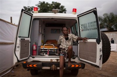 """In this photo taken on Wednesday, Sept. 24, 2014, a woman suspected of suffering from the Ebola virus sits in an ambulance in Kenema, Sierra Leone. Sierra Leone restricted travel Thursday, Sept. 25, 2014 in three more """"hotspots"""" of Ebola where more than 1 million people live, meaning about a third of the country's population is now under quarantine. Sierra Leone is one of the hardest hit countries in the Ebola outbreak sweeping West Africa that is believed to have killed more than 2,900 people, according to World Health Organization tolls published Thursday. (AP Photo/ Tanya Bindra)"""