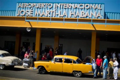 People put their luggage in a private taxi as they arrive from the U.S. to the Jose Marti International Airport in Havana, Cuba, Monday, Sept. 1, 2014. Cubans braced Monday for a clampdown on the flow of car tires, flat-screen televisions, blue jeans and shampoo in the bags of travelers who haul eye-popping amounts of foreign-bought merchandise to an island where consumer goods are frequently shoddy, scarce and expensive. (AP Photo/Ramon Espinosa)