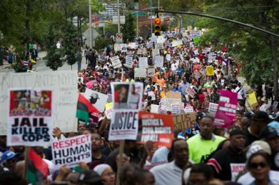 In this Aug. 23, 2014 file photo, demonstrators march to protest the death of Eric Garner in the Staten Island borough of New York. The city medical examiner ruled that Garner, 43, died as a result of a police chokehold during an attempted arrest. Details may differ, circumstances of their deaths may remain unknown, but the outrage that erupted after the Aug. 9 fatal shooting of the unarmed, black 18-year-old by a white officer in Ferguson, Missouri, has become a rallying cry in protests over police killings across the nation. (AP Photo/John Minchillo, File)