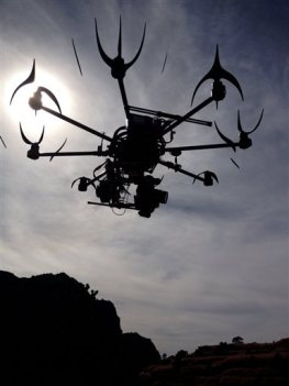 This image provided by Aerial MOB, LLC, shows their eight rotor Sky Jib Helicopter in San Diego, Calif., in August 2013. The Federal Aviation Administration is expected to announce Thursday, Sept. 26,  that it is granting permits to seven movie and television production companies to fly drones, including those from Aerial MOB, LLC, an important step toward greater use of the technology by commercial operators, said attorneys and a company official familiar with the decision. The seven companies have been working with the Motion Picture Association of America for two years to win approval from the FAA. (AP Photo/Aerial MOB, LLC, Tony Carmean)