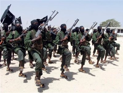 In this Feb.17, 2011 file photo, hundreds of newly trained al-Shabab fighters perform military exercises in the Lafofe area some 18 kilometers (12 miles) south of Mogadishu, Somalia. U.S. military forces targeted the Islamic extremist al-Shabab network in an operation Monday, Sept. 1, 2014 in Somalia, the Pentagon said. (AP Photo/Farah Abdi Warsameh, File)