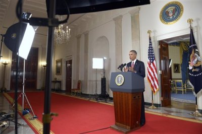 """President Barack Obama addresses the nation from the Cross Hall in the White House in Washington, Wednesday, Sept. 10, 2014. In a major reversal, Obama ordered the United States into a broad military campaign to """"degrade and ultimately destroy"""" militants in two volatile Middle East nations, authorizing airstrikes inside Syria for the first time, as well as an expansion of strikes in Iraq.  (AP Photo/Saul Loeb, Pool)"""
