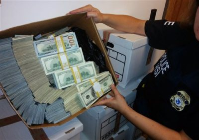 This photo provided by U.S. Immigration and Customs Enforcement shows a box of cash part of what was seized by Homeland Security Investigations in Los Angeles on Wednesday, Sept. 10, 2014. Federal authorities have arrested nine people and seized roughly $65 million in a crackdown on suspected drug money laundering in the fashion district of Los Angeles. (AP Photo/U.S. Immigration and Customs Enforcement)