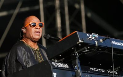 """In this June 29, 2014 file photo, US singer Stevie Wonder performs at the Calling festival, in London. Wonder said the mayor of Ferguson, Mo., isn't seeing the full picture a month after an unarmed black teenager was killed by a white police officer. """"I don't know if the mayor has blinders on,"""" Wonder said in an interview Wednesday, Sept. 10, 2014. """"But to say that he didn't know that there was a racial or cultural problem in the city is unfortunate."""" (Photo by Jim Ross/Invision/AP)"""