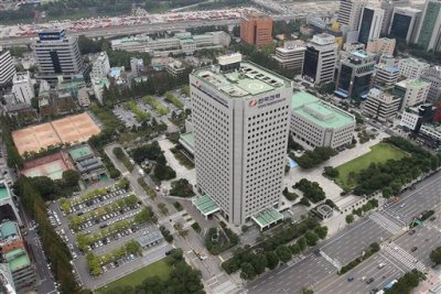 This Sept. 17, 2014 photo, shows Korea Electric Power Corp's headquarters, center, in Seoul, South Korea. The consortium led by Hyundai Motor Co. offered 10.55 trillion won ($10.1 billion) for land in Seoul's tony Gangnam district where it will build a new headquarters, on Thursday, Sept. 18, 2014. (AP Photo/Yonhap, Han Jong-chan)