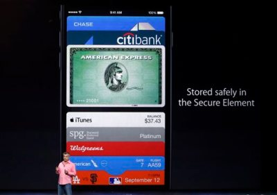 Eddy Cue, Apple Senior Vice President of Internet Software and Services, discusses the new Apple Pay product on Tuesday, Sept. 9, 2014, in Cupertino, Calif. (AP Photo/Marcio Jose Sanchez)