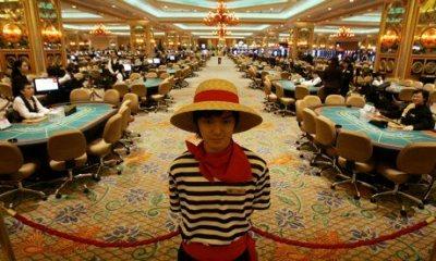 Gambling tables inside the casino at the Venetian Macao Resort Hotel. (Kin Cheung/AP)