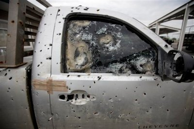 """In this Sept. 5, 2014 photo, an armored truck riddled with bullet holes sits at a military base in Ciudad Mier, in Tamaulipas state, Mexico. The military says they confiscate vehicles that are abandoned by their drivers after armed fights among cartels or with the military, so that gangs cannot reuse vehicles parts. """"The energy reform won't be viable if we aren't successful ... in solving the problem of crime and impunity,"""" said Mexican Senator David Penchyna, who heads the Senate Energy Commission. """"The biggest challenge we Mexicans have, and I say it without shame, is Tamaulipas."""" (AP Photo/Eduardo Verdugo)"""
