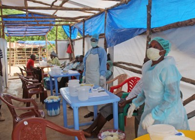 This is a Sunday, July 27, 2014 file photo of medical personnel inside a clinic taking care of Ebola patients in the Kenema District on the outskirts of Kenema, Sierra Leone. On July 23 the doctor in charge of battling Sierra Leone's current Ebola outbreak became ill with the deadly disease, the country's health minister confirmed. He later died. (AP Photo/ Youssouf Bah, File)