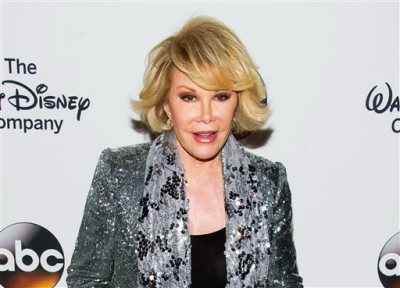 In this May 14, 2014 file photo, TV personality Joan Rivers attends A Celebration of Barbara Walters in New York. Melissa Rivers announced Thursday, Sept. 4, that her mother Joan died Thursday, in New York. Rivers was hospitalized Aug. 28, after going into cardiac arrest at a doctor's office. (Photo by Charles Sykes/Invision/AP, File)