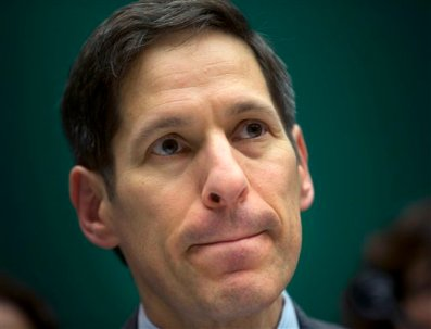 """In this Oct. 16, 2014, photo, Centers for Disease Control and Prevention Director Dr. Tom Frieden testifies on Capitol Hill in Washington.  Last May, as Ebola crept across West Africa, America's top infectious disease expert told a group of Harvard students in a commencement speech to always second-guess their assumptions because """"overconfidence can kill.""""Five months later in a hearing room on Capitol Hill, Frieden was accused of not following his own advice _ repeatedly assuring the nation it was safe from an Ebola outbreak even as two U.S. nurses became infected and one was allowed to board a commercial airline, each following safety protocols Frieden helped put in place.  (AP Photo/Pablo Martinez Monsivais)"""