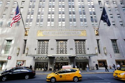 A taxi passes in front of the fabled Waldorf Astoria hotel, Monday, Oct. 6, 2014 in New York. Hilton Worldwide is selling the Waldorf Astoria New York to Chinese insurance company Anbang Insurance Group Co. for $1.95 billion. Hilton Worldwide will continue to manage the storied hotel for the next 100 years as part of an agreement with Anbang. (AP Photo/Mark Lennihan)