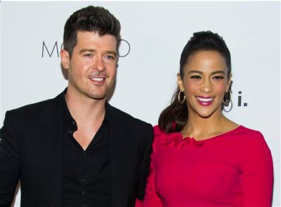 "In this Wednesday, Oct. 23, 2013 file photo, Robin Thicke and Paula Patton attend the sixth annual GQ Gentlemen's Ball in New York. Patton has filed for divorce from Thicke and is asking for joint custody of their son. Patton filed in Los Angeles on Friday, Oct. 3, 2014, citing ""irreconcilable differences."" (Photo by Charles Sykes/Invision/AP, file)"