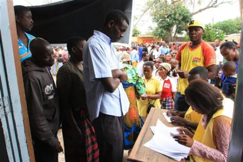 Voters produce identity documents as they go through the voting process at a polling station, in Maputo, Mozambique, Wednesday, Oct. 15, 2014. Voting in Mozambique's national election began peacefully Wednesday. The election comes just months after a peace accord between the ruling Frelimo party and the opposition, Renamo, ended nearly two years of sporadic fighting in the north of the country. (AP Photo/Ferhat Momade)