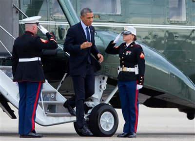 President Barack Obama, salutes Marines honor guards as he disembarks from Marine One to switch to Air Force One at Andrews Air Force Base, Md., Tuesday, Oct. 7,  2014, for a trip to New York City and Greenwich, Conn. (AP Photo/Manuel Balce Ceneta)