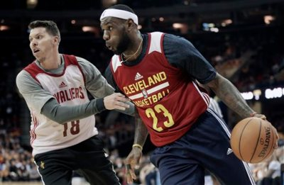 Cleveland Cavaliers' LeBron James (23) drives past Mike Miller (18) during an NBA scrimmage basketball game Wednesday, Oct. 1, 2014, in Cleveland. (AP Photo/Tony Dejak)