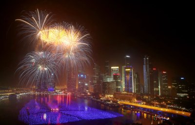 Fireworks explode over the financial district at midnight, Wednesday, Jan. 1, 2014 in Singapore. (AP Photo/Wong Maye-E)