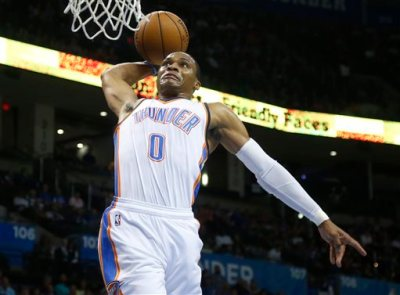Oklahoma City Thunder guard Russell Westbrook goes up for a dunk in the first quarter of the Thunder's preseason NBA basketball game against the Utah Jazz in Oklahoma City, Tuesday, Oct. 21, 2014. (AP Photo/Sue Ogrocki)