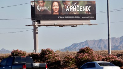 A University of Phoenix billboard is shown in Chandler, Ariz. (AP Photo)