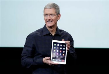Apple CEO Tim Cook introduces the new Apple iPad Air 2 during an event at Apple headquarters on Thursday, Oct. 16, 2014 in Cupertino, Calif. (AP Photo/Marcio Jose Sanchez)