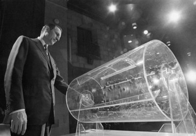 Draft Director Curtis W. Tarr spins one of the two Plexiglas drums in Washington on Feb. 2, 1972, as the fourth annual Selective Service lottery begins. Inside are capsules containing birth dates and orders of assignment for men born in 1953. (Charles W. Harrity/AP)