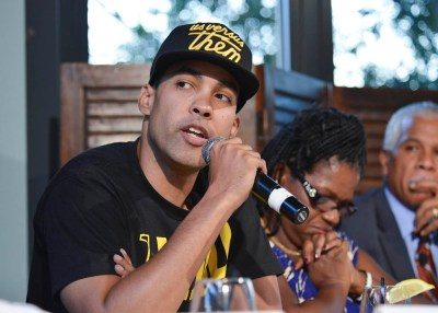 Jasiri X speaks during a panel discussion on Ferguson, Mo., and police brutality in the Black community in Washington, D.C. in August. (Freddie Allen/NNPA)