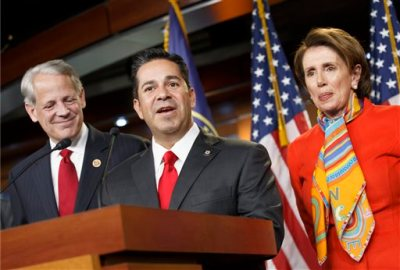 Rep. Ben Ray Lujan, D-N.M., center, thanks House Minority Leader Nancy Pelosi, D-Calif., right, after she announced he will take over as head of the Democratic Congressional Campaign Committee from Rep. Steve Israel, D-N.Y., left, during a news conference at the Capitol in Washington, Monday, Nov. 17, 2014. (AP Photo)