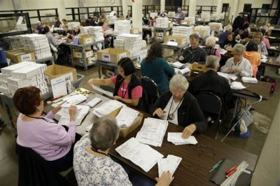 Election workers open Oregon ballots and check signatures at Multnomah County election headquarters in Portland, Ore., Monday, Nov. 3, 2014. On the eve of an election that will decide the Senate majority, it's time for closing arguments and an all-out effort to motivate people to vote, Republicans have claimed new momentum in midterm campaigns that have centered on President Barack Obama, who is not on Tuesday's ballot. Under the weight of the unpopular president, Democrats are fighting to distance themselves from the White House and convince voters they deserve to maintain the Senate majority for the final two years of Obama's presidency. The GOP is sounding confident that it will take Senate control.  (AP Photo/Don Ryan)