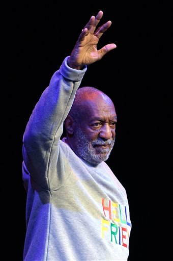 Comedian Bill Cosby waves to the crowd as he walks onstage at the beginning of his performance at the Maxwell C. King Center for the Performing Arts, in Melbourne, Fla., Friday, Nov. 21, 2014. Performances by Cosby in Nevada, Illinois, Arizona, South Carolina and Washington state have been canceled as more women come forward accusing the entertainer of sexually assaulting them years ago. (AP Photo/Phelan M. Ebenhack)