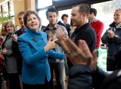 Sen. Jeanne Shaheen, D-N.H. acknowledges supporters during a campaign stop, at the cafe inside Gibson's Bookstore Monday, Nov. 3, 2014 in Concord, N.H. The incumbent U.S. Senator is seeking re-election against former Massachusetts Sen. Republican Scott Brown in Tuesday's election. (AP Photo/Jim Cole)