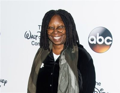 "In this May 14, 2014 file photo, co-host Whoopi Goldberg attends the ""A Celebration of Barbara Walters,"" celebration in New York. Goldberg has a deal with Hachette Books for a ""provocative"" take on the ""downsides"" of marriage, the publisher announced Tuesday, Nov. 11. The book, currently untitled, is scheduled to come out next September. (Photo by Charles Sykes/Invision/AP, File)"
