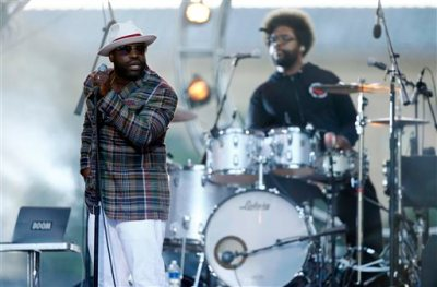 "In this July 4, 2014 file photo, Tariq ""Black Thought"" Trotter, left, and Ahmir ""Questlove"" Thompson of The Roots, perform during an Independence Day celebration in Philadelphia. The Roots are tapping into their resources to help raise funds for their high-school alma mater in Philadelphia. The Grammy-winning hip-hop band created the CAPA Foundation after learning that $1.1 million had been cut from the budget of the Philadelphia High School for Creative and Performing Arts. (AP Photo/Matt Rourke, File)"