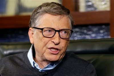 In this May 5, 2014 file photo, Microsoft co-founder and Berkshire Hathaway board member Bill Gates speaks during an interview with Liz Claman on the Fox Business Network in Omaha, Neb. Gates says he wants to end malaria in his lifetime and will raise his donations toward that goal by 30 percent, to more than $200 million per year. (AP Photo/Nati Harnik, File)