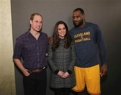 Britain's Prince William, left, and Kate, Duchess of Cambridge pose with Cleveland Cavaliers' LeBron James, right, backstage of an NBA basketball game between the Cavaliers and the Brooklyn Nets on Monday, Dec. 8, 2014, in New York. (AP Photo/Neilson Barnard, Pool)