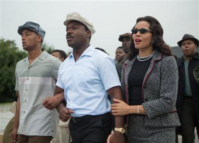 """This photo released by Paramount Pictures shows, David Oyelowo, center, as Martin Luther King, Jr. and Carmen Ejogo, right, as Coretta Scott King in the film, """"Selma,"""" from Paramount Pictures and Pathé. The Civil Rights march drama is up for eight NAACP Image Awards honoring diversity in the arts, including outstanding motion picture; lead actor for David Oyelowo; supporting actor for Andre Holland, Common and Wendell Pierce; supporting actress for Carmen Ejogo and Oprah Winfrey; and director for Ava DuVernay. The awards will be presented in a Feb. 6 ceremony airing on the TV One channel. (AP Photo/Paramount Pictures, Atsushi Nishijima)"""