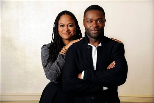 """FILE - In this Wednesday, Nov. 12, 2014 file photo, Ava DuVernay, left, director of the film """"Selma,"""" and cast member, David Oyelowo, who plays Martin Luther King Jr., pose together at the Four Seasons Hotel in Los Angeles.  The widely acclaimed movie """"Selma"""" about the 1965 Civil Rights movement has disappointed at least one moviegoer: a leading historian of President Lyndon B. Johnson. The director of the LBJ Presidential Library in Austin, which hosted a major civil rights summit this year that was headlined by four U.S. presidents, said the film that opens in theaters Thursday, Dec. 25, 2014, incorrectly portrays Johnson as an obstructionist to the Rev. Dr. Martin Luther King Jr. (Photo by Chris Pizzello/Invision/AP)"""