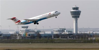 In this April 1, 2014 file photo, a Austrian Airlines airplane takes off from the airport in Munich, southern Germany. Flying could get cheaper next year as airlines say they will finally start passing on some of the savings made on plummeting oil prices. (AP Photo/Matthias Schrader, File)