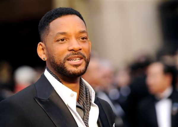"""In this March 2, 2014 file photo, Will Smith arrives at the Oscars at the Dolby Theatre in Los Angeles. Smith, Jared Leto and Tom Hardy are suiting up for DC Comics' supervillain team-up film """"Suicide Squad."""" Warner Bros. confirmed the much anticipated casting of the film in an announcement Tuesday, Dec. 2, 2014.  (Photo by Chris Pizzello/Invision/AP, File)"""