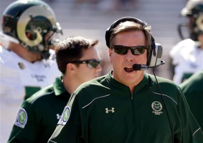 In this Sept. 27, 2014, file photo, Colorado State head coach Jim McElwain talks in his headset during the first quarter of an NCAA college football game against Boston College in Boston. A person familiar with the search says Florida has hired McElwain as its next football coach. The person spoke to The Associated Press on Thursday, Dec. 4, 2014, on the condition of anonymity because the Gators have not announced details of their coaching search. The person says McElwain officially accepted the job Wednesday after working out deal to reduce a $7.5 million buyout. (AP Photo/Stephan Savoia, File)