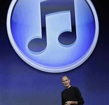 Then-Apple CEO Steve Jobs stands with the new iTunes logo at a news conference in San Francisco, Wednesday, Sept. 1, 2010. (AP Photo/Paul Sakuma)