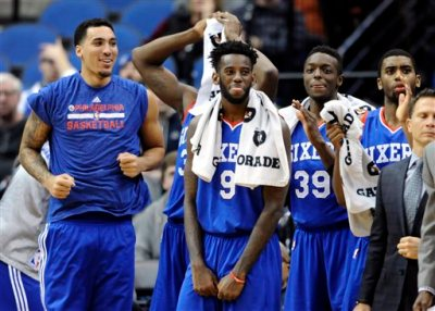Philadelphia 76ers center Drew Gordon, left, forward JaKarr Sampson (9), forward Jerami Grant (39) and guard Hollis Thompson watch from the bench in the fourth quarter of an NBA basketball game against the Minnesota Timberwolves, Wednesday, Dec. 3, 2014, in Minneapolis. The 76ers avoided tying the record for the worst start to a season in NBA history, ending their 0-17 skid with an 85-77 victory over the Timberwolves on Wednesday night. (AP Photo/Hannah Foslien)